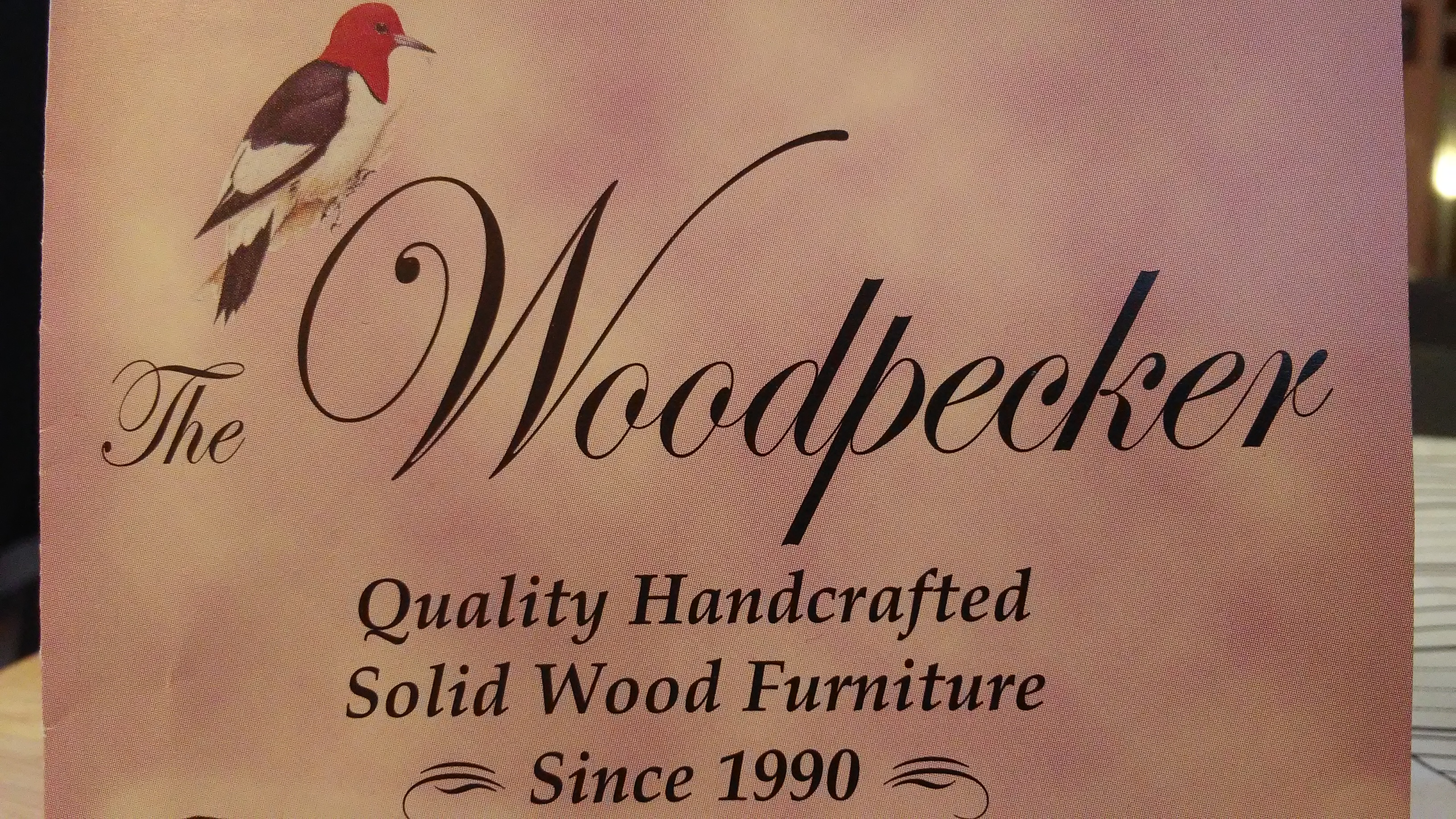 The Woodpecker Logo